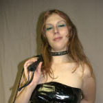 Femdom Mistress fetish vinyl crop impact whipping
